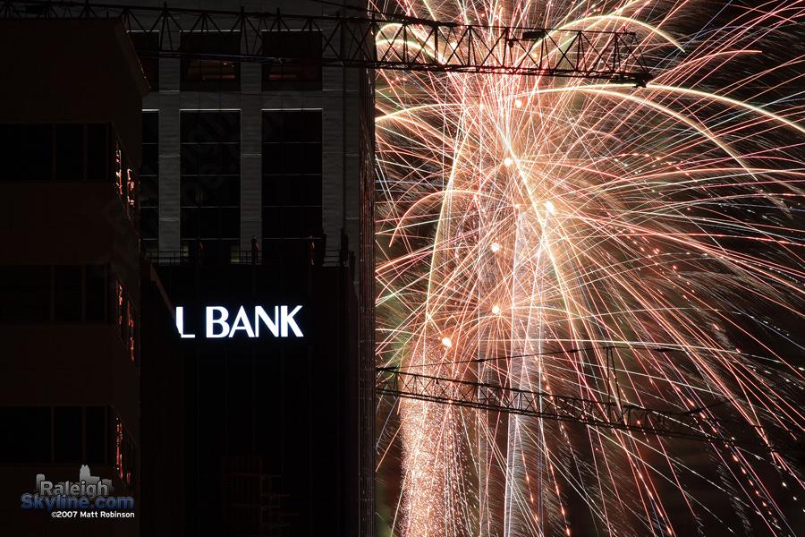 Crane silhouette in fireworks.