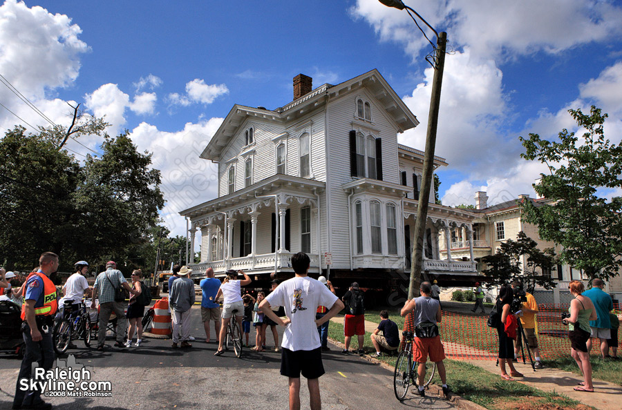 Crowds gather to watch a Raleigh house move a few blocks.
