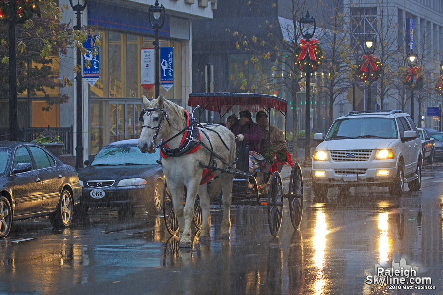 Horse Carriage in the early December snow on Fayetteville Street